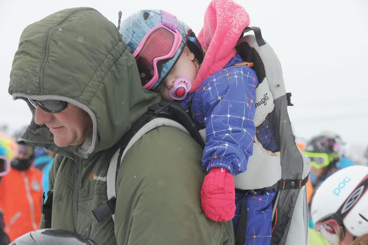 The racing action was a bit too much for 2-year-old Harlow Kuntz, who elected to take a nap on father Don's back while watching her siblings at Friday's Soda Pop Slalom. The long-running Winter Carnival event is where many Alpine ski racers in Steamboat Springs get their start.
