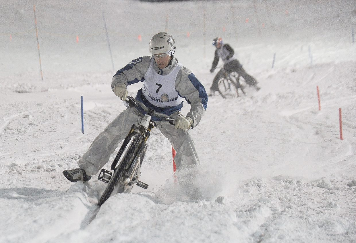 Petr Hanak races to victory in the quarterfinals of the dual slalom bike race Friday evening at Howelsen Hill. Hanak went on to win the annual Winter Carnival event.