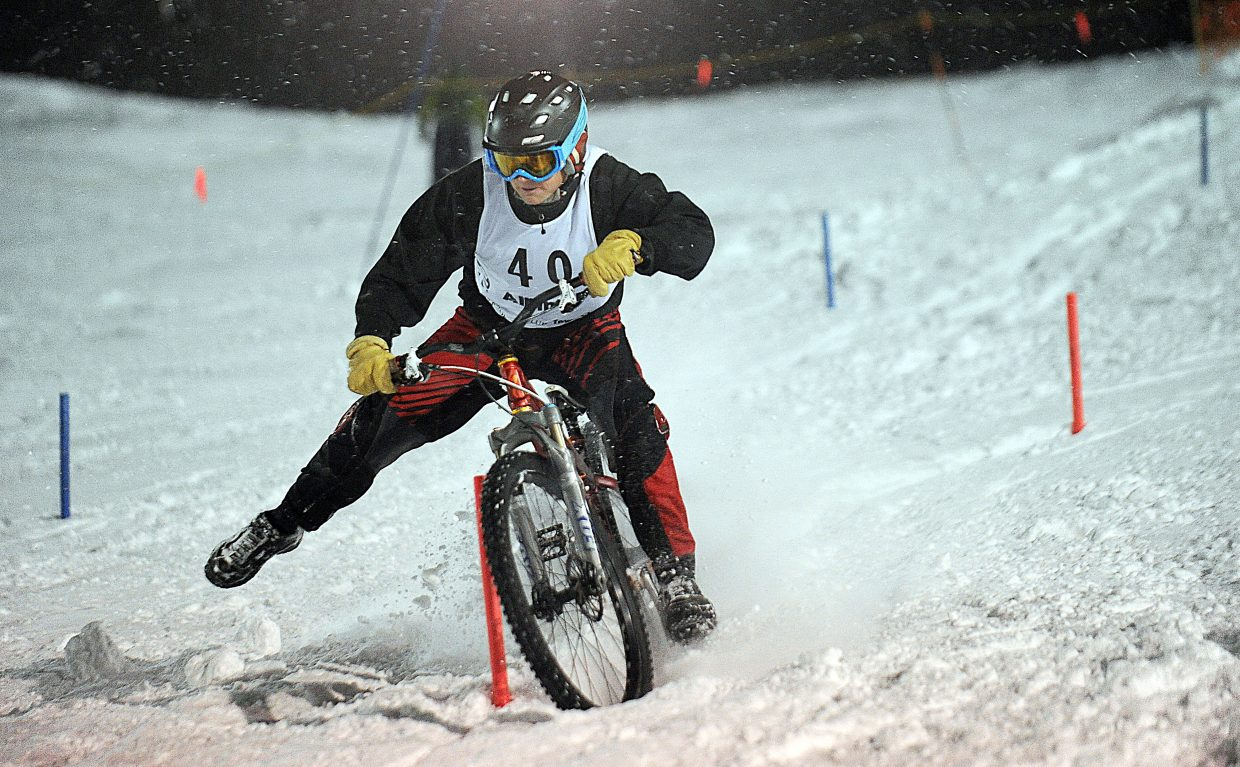 Trevyn Newpher clears a gate during qualifying for the 101st Winter Carnival dual bike slalom race Friday evening at Howelsen Hill. Newpher advanced to the finals before losing a tight race to Petr Hanak, who won the event.