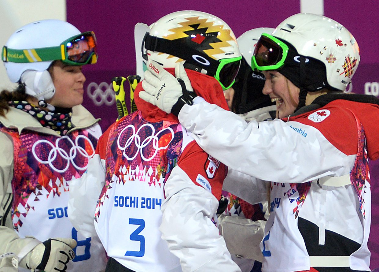Sisters Justine Dufour-Lapointe and Chloe Dufour-Lapointe embrace after Justine's run Saturday in the women's mogul finals. At that point, they knew they'd both medal. A few moments later, they learned those medals would be gold and silver.
