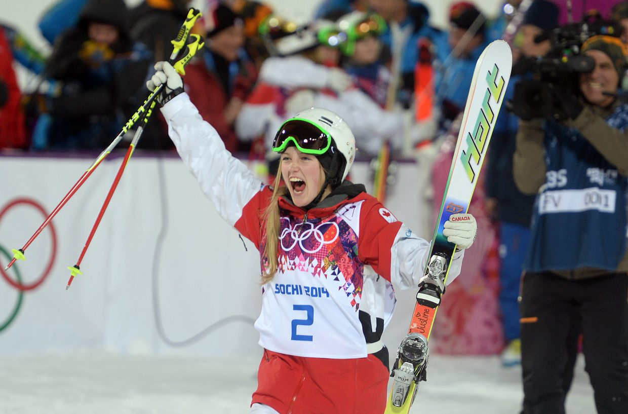 Justine Dufour-Lapointe celebrates gold Saturday in Russia at the 2014 Winter Olympics.