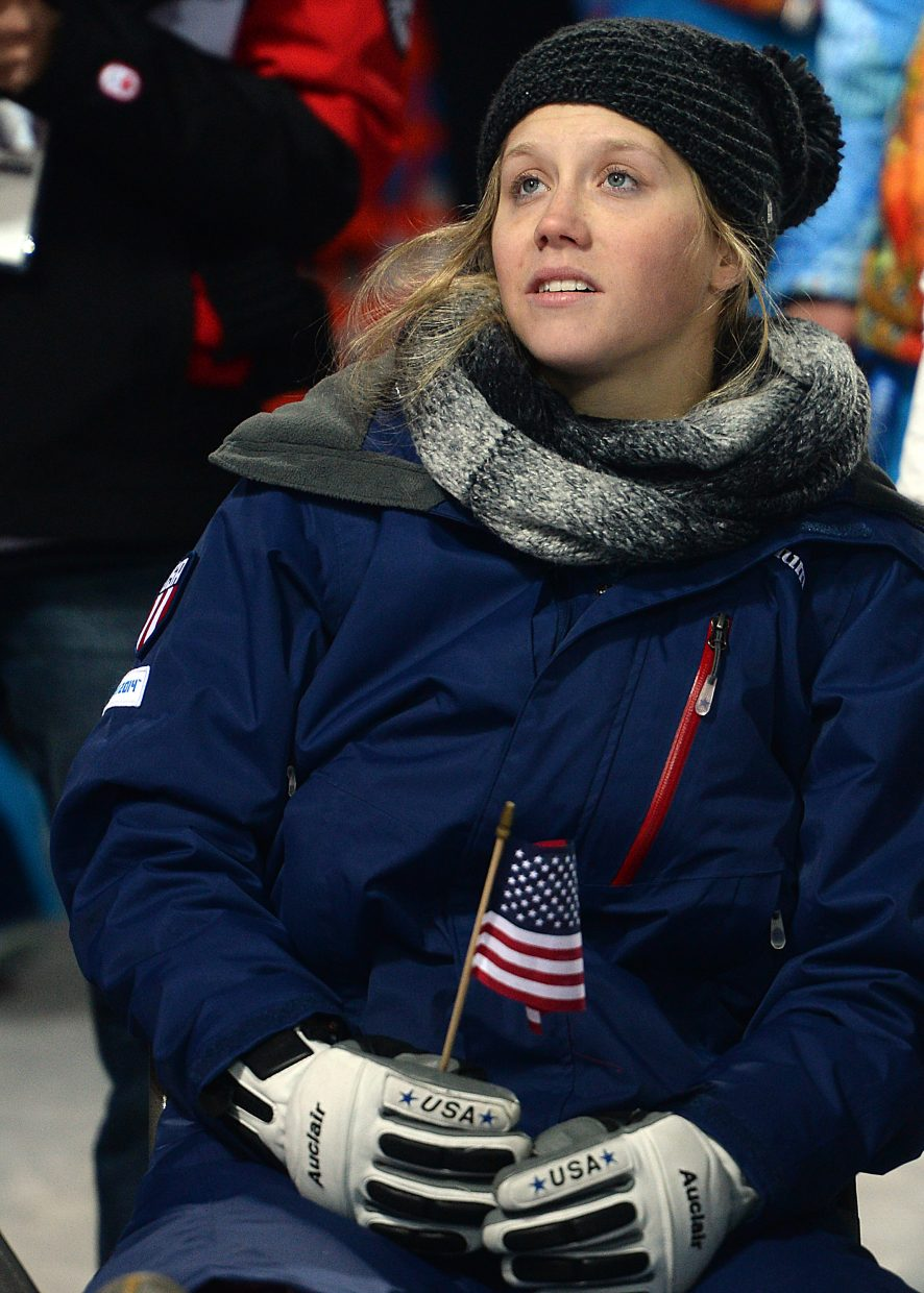 U.S. Olympic moguls skier Heidi Kloser, a Vail product, only could watch and cheer as her teammates competed Saturday in the women's moguls finals. Kloser missed the competition after injuring her knee earlier this week in training.