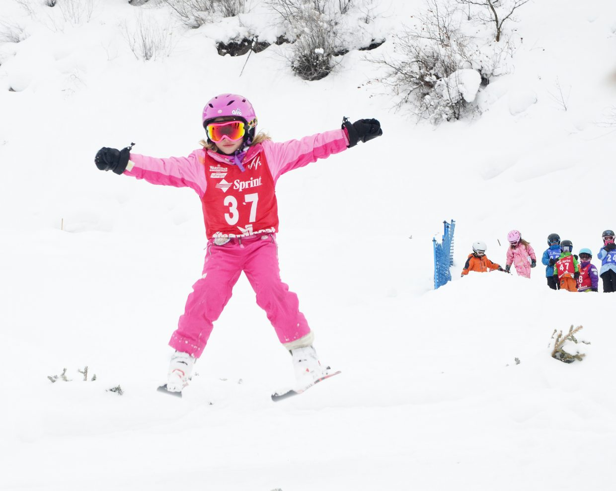 Kiki Croke, 7, lands a good jump off the HS 20 ski jump Friday at Howelsen Hill during Steamboat Springs' 101st Winter Carnival.