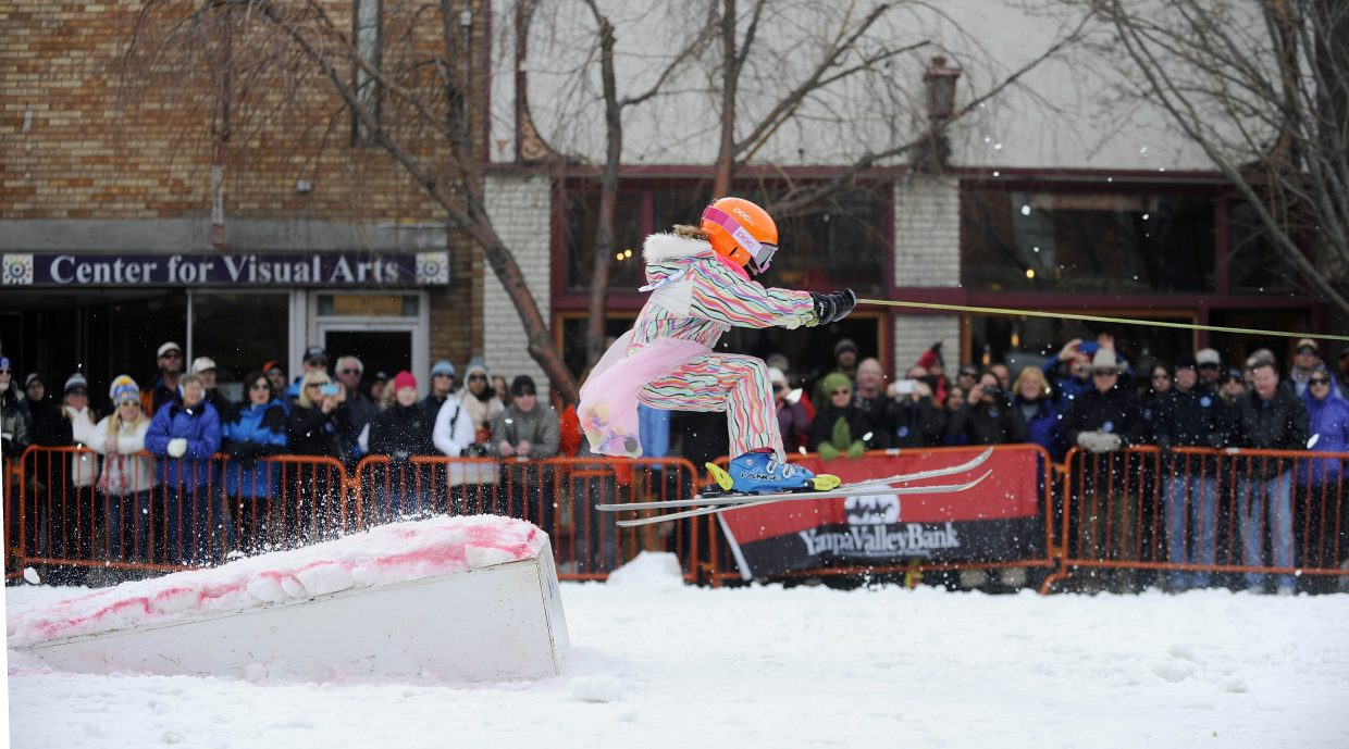 Abby Olson competes in the donkey jump competition Saturday during the Winter Carnival street events.