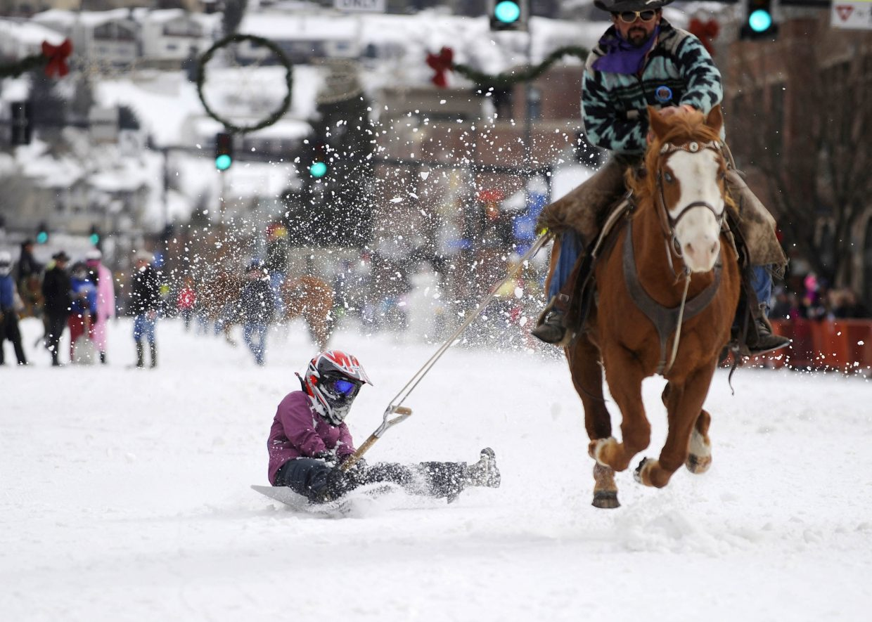 Michelle Barnes competes in the shovel race competition Saturday during the Winter Carnival street events.
