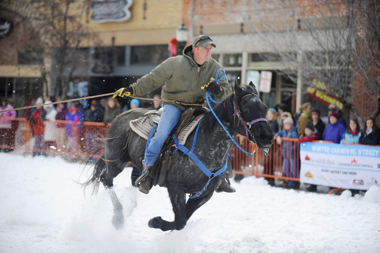 Dave Gittleson pulls a skier Saturday during the Winter Carnival street events ski joring competition.