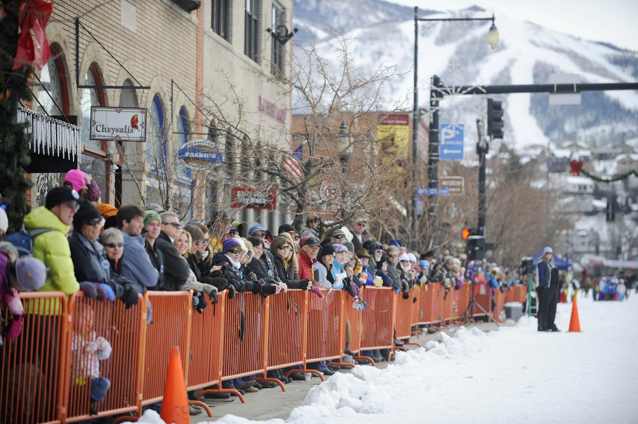 Spectators line Lincoln Avenue on Saturday during the Winter Carnival street events.
