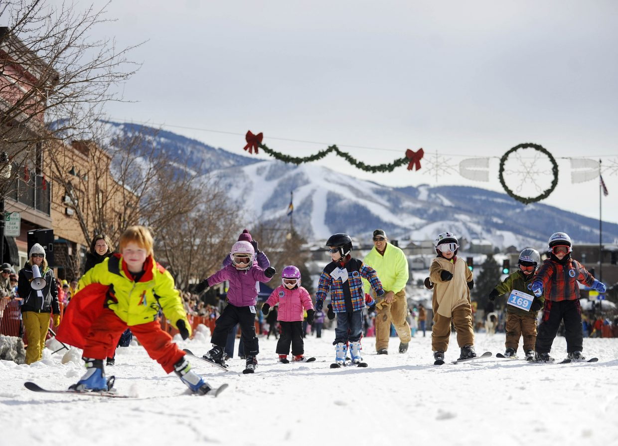 Children between the ages of 3 and 5 compete in the 25-yard dash on Saturday during the Winter Carnival street events.