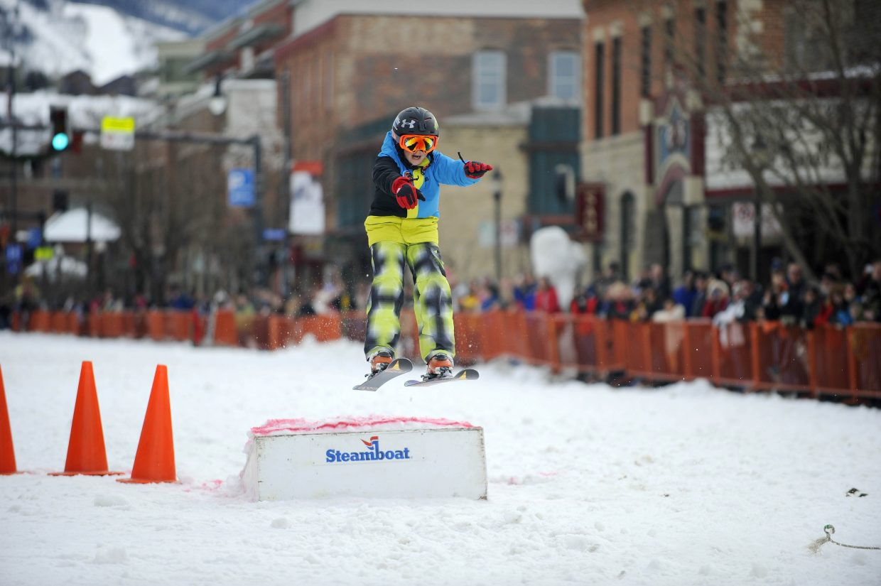 Charlie Thompson competes in the donkey jump competition Saturday during the Winter Carnival street events.
