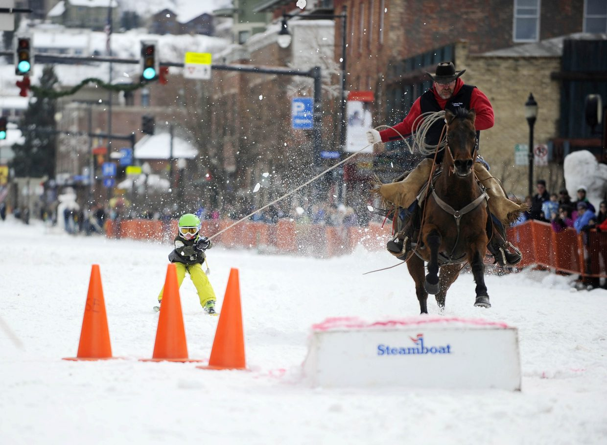 Doug Wheeler pulls Wiley Wagner during the donkey jump competition Saturday during the Winter Carnival street events.