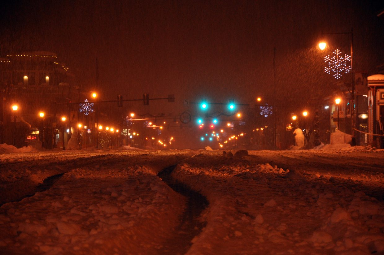 Lincoln Avenue waits for the groomer early Saturday morning as snow continues to fall before the start of the Winter Carnival. The city lays down about 2,000 cubic yards of snow to make the street events and parade happen.