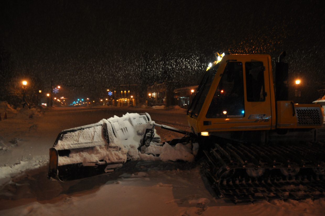 Shawn Tompkins grooms Lincoln Avenue at 6 a.m. Saturday in advance of the street events for the 101st Winter Carnival.