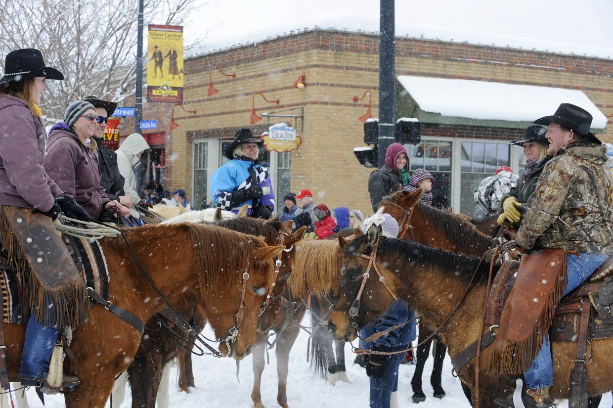 Horseback riders visit in between events during the Winter Carnival street events Saturday.