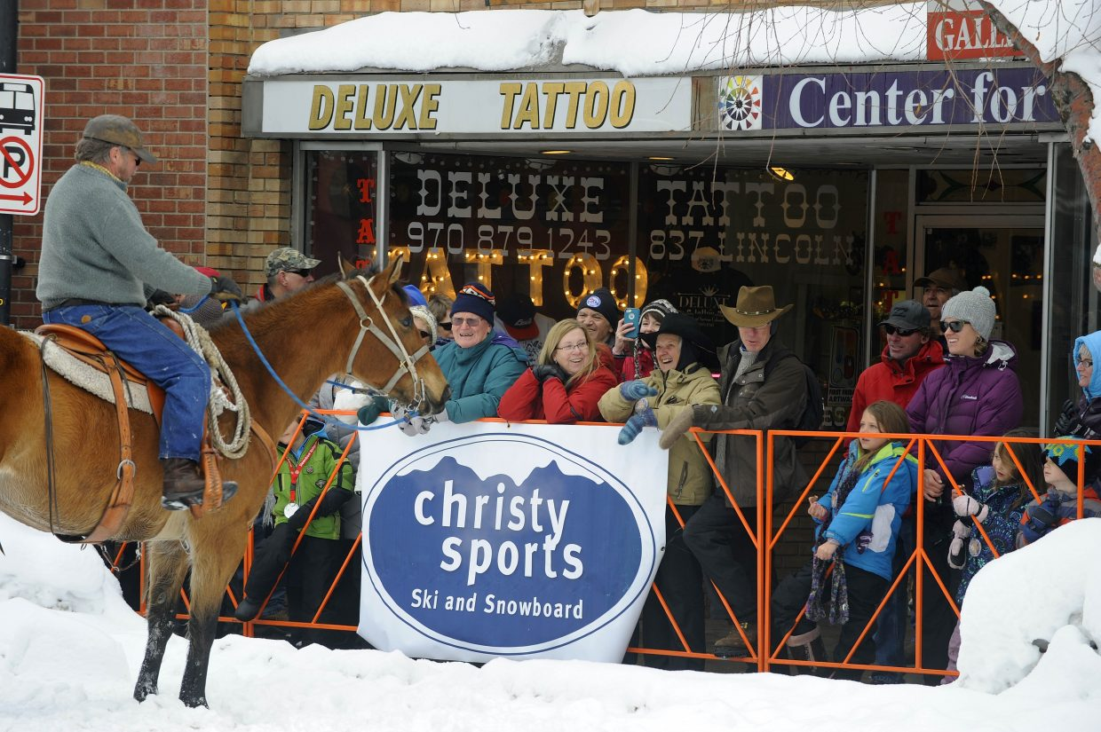 Spectators get to visit with one of the horses riding in the Winter Carnival street events Saturday.