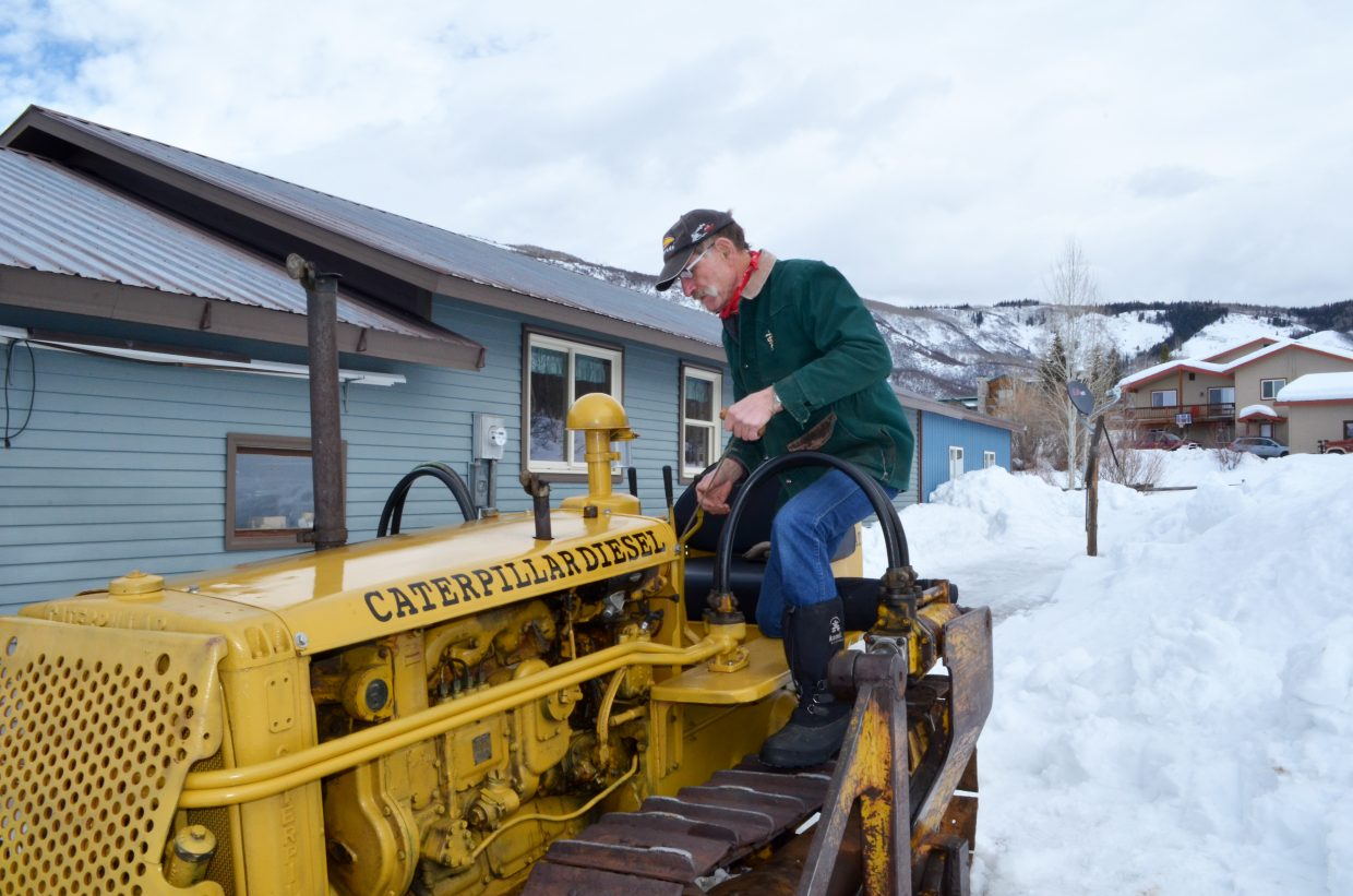 When Bill Fetcher first spied his 1947 Caterpillar D2 bulldozer in a yard in Moonhill Meadows, there was a tree growing through it. Since then, he has restored it, and uses the little dozer to plow snow.