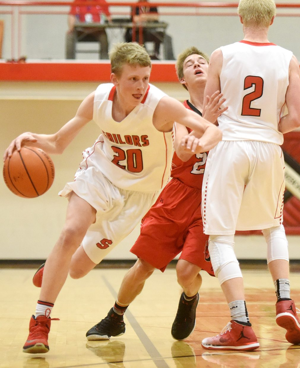 Steamboat sophomore Mac Riniker drives the lane around a pick set by his brother, Ethan Riniker, on Thursday as the Sailors beat Glenwood Springs.