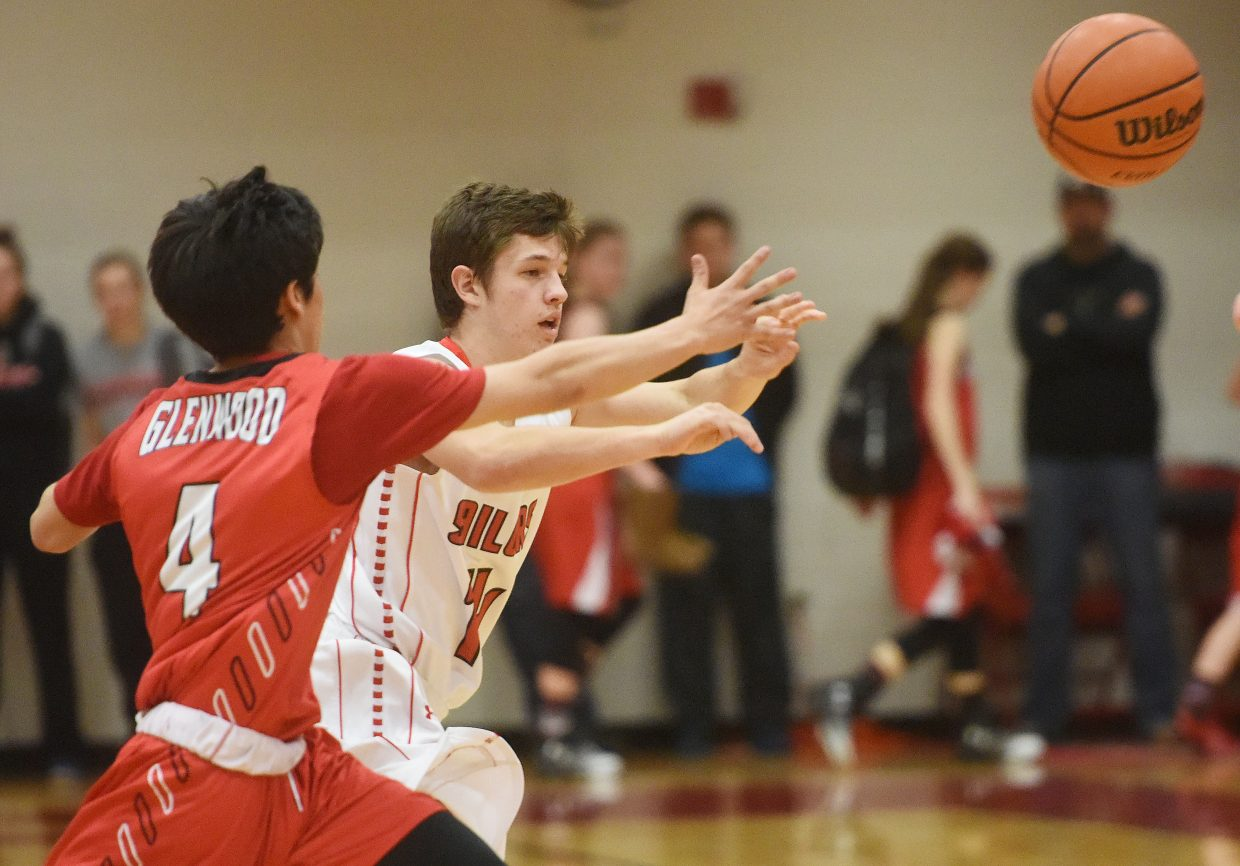 Ethan Pyles launches a pass across the court Thursday against Glenwood Springs.