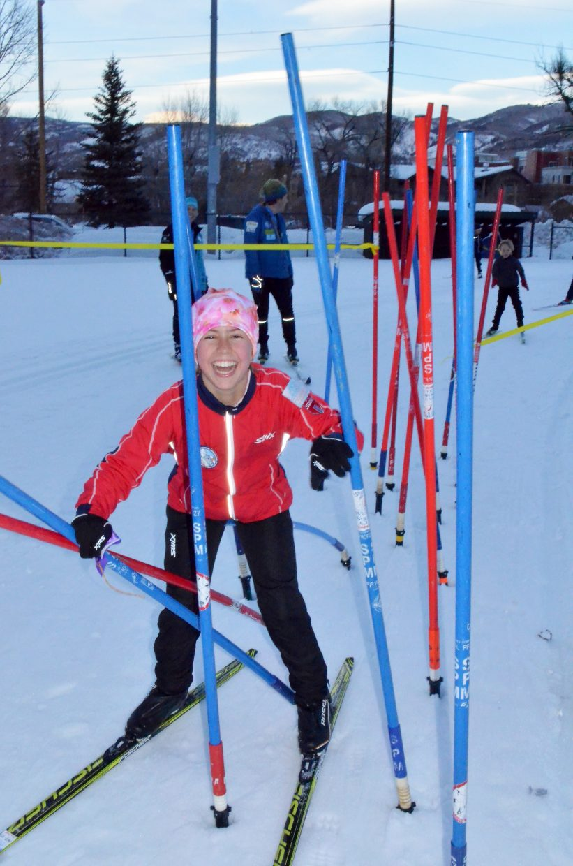 Suzy Magill 12, battled her way through the bamboo forest with high spirits during the Winter Carnival cross-country obstacle race Feb. 9 at Howelsen Hill.