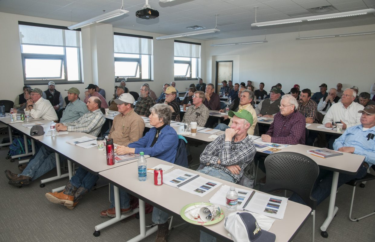 """Northwest Colorado ranchers and landowners learn about managing greater sage grouse habitat from Colorado Parks and Wildlife habitat coordinators Trevor Balzer and Jim Garner at Colorado Northwestern Community College in Craig on Wednesday. CPW and Colorado Cattlemen's Association hosted two landowner workshops titled """"Ranching for Greater Sage Grouse"""" in Craig and Steamboat Springs this week to share information and tools on how to preserve greater sage grouse habitat."""
