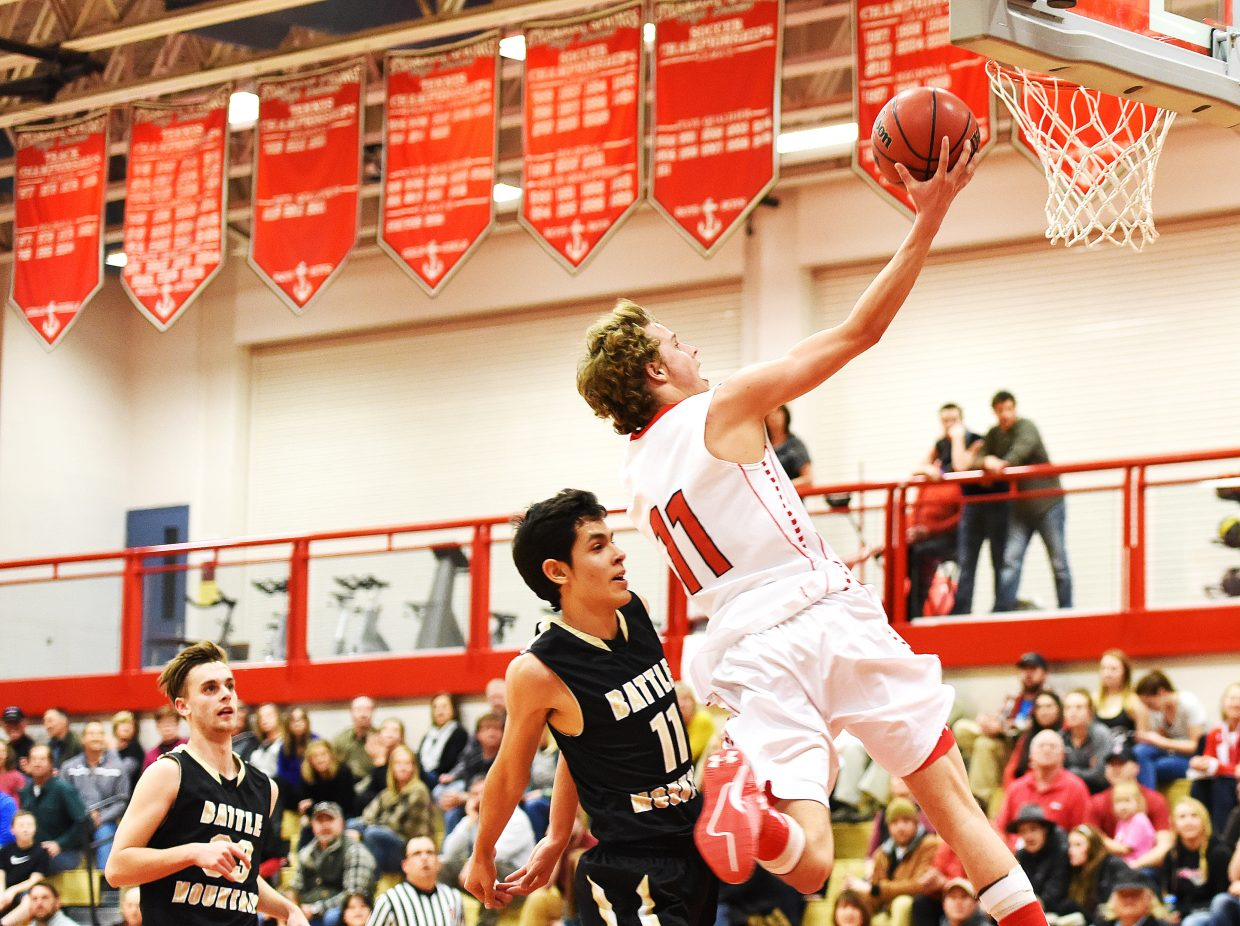 Steamboat senior Austin Kerbs goes high to lay in a basket Tuesday against Battle Mountain. Kerbs finished with 11 points, helping the Sailors come back from a first-half hole to beat the Huskies, 45-33.