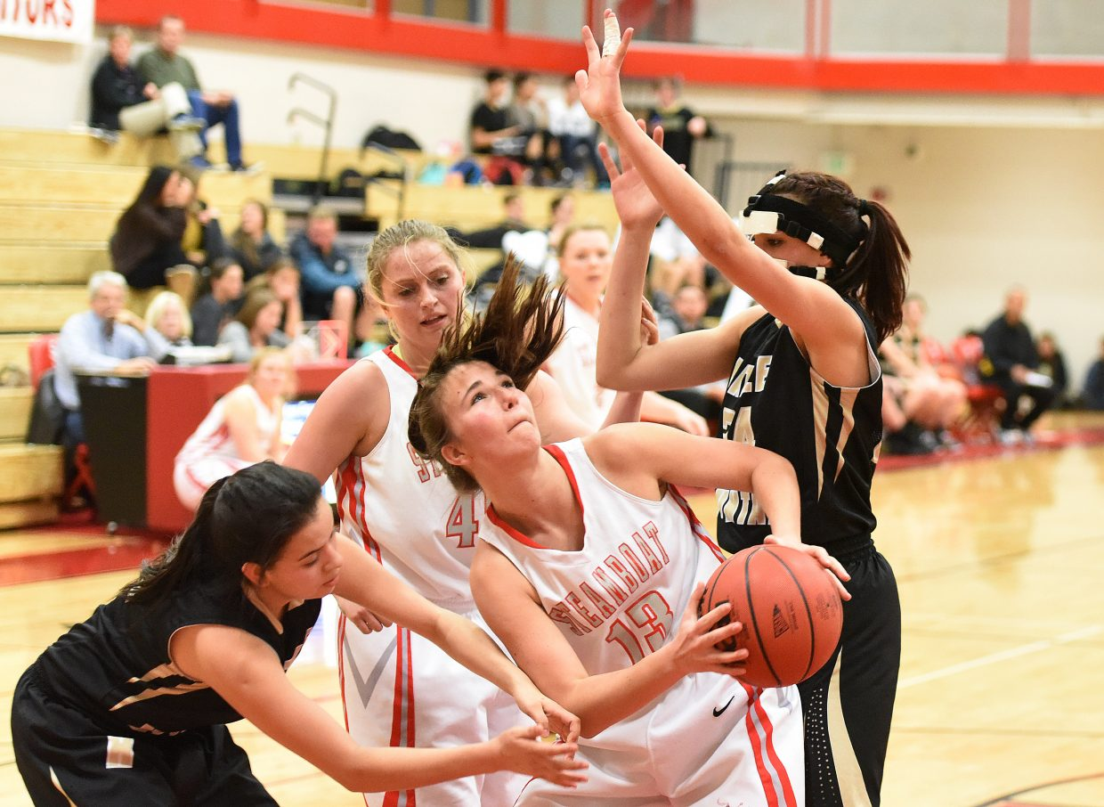 Steamboat's Savannah Baucknecht tries to find a way to put up a shot Tuesday against Battle Mountain. The Sailors lost the game, 39-20.