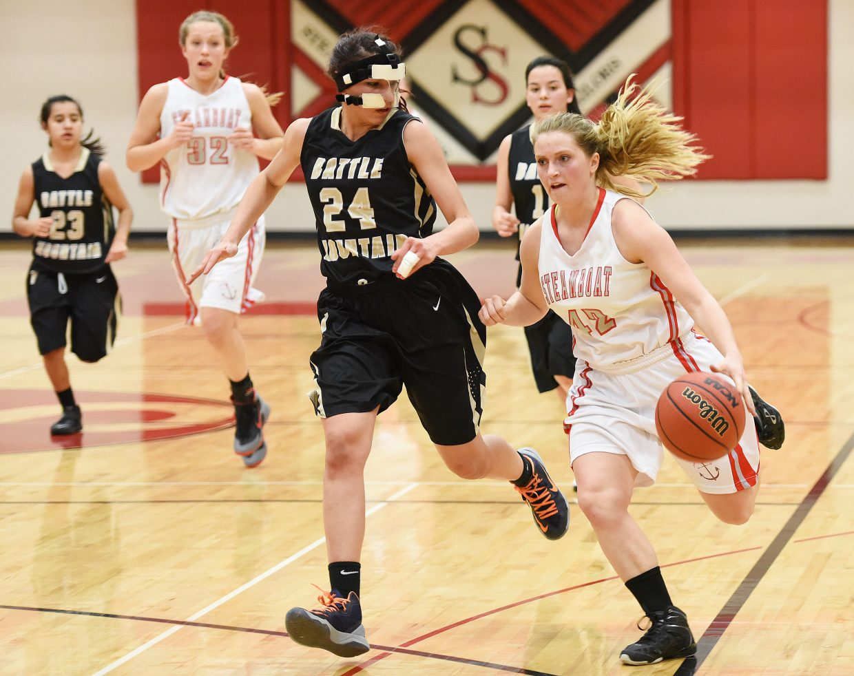 Steamboat's Alexandrea Bryant drives down the court Tuesday.