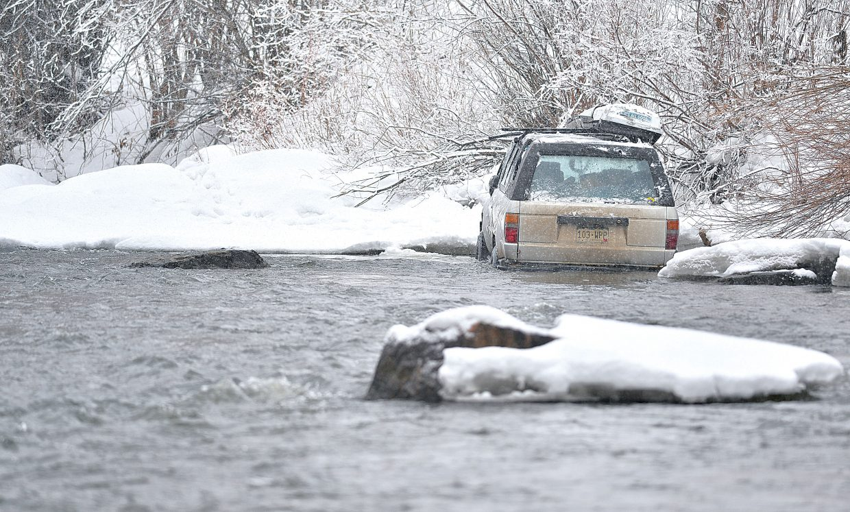 A one-car rollover on River Road left this vehicle in the cold water of the Yampa River Tuesday morning. The driver was able to get out of the vehicle and get to safety without injury.