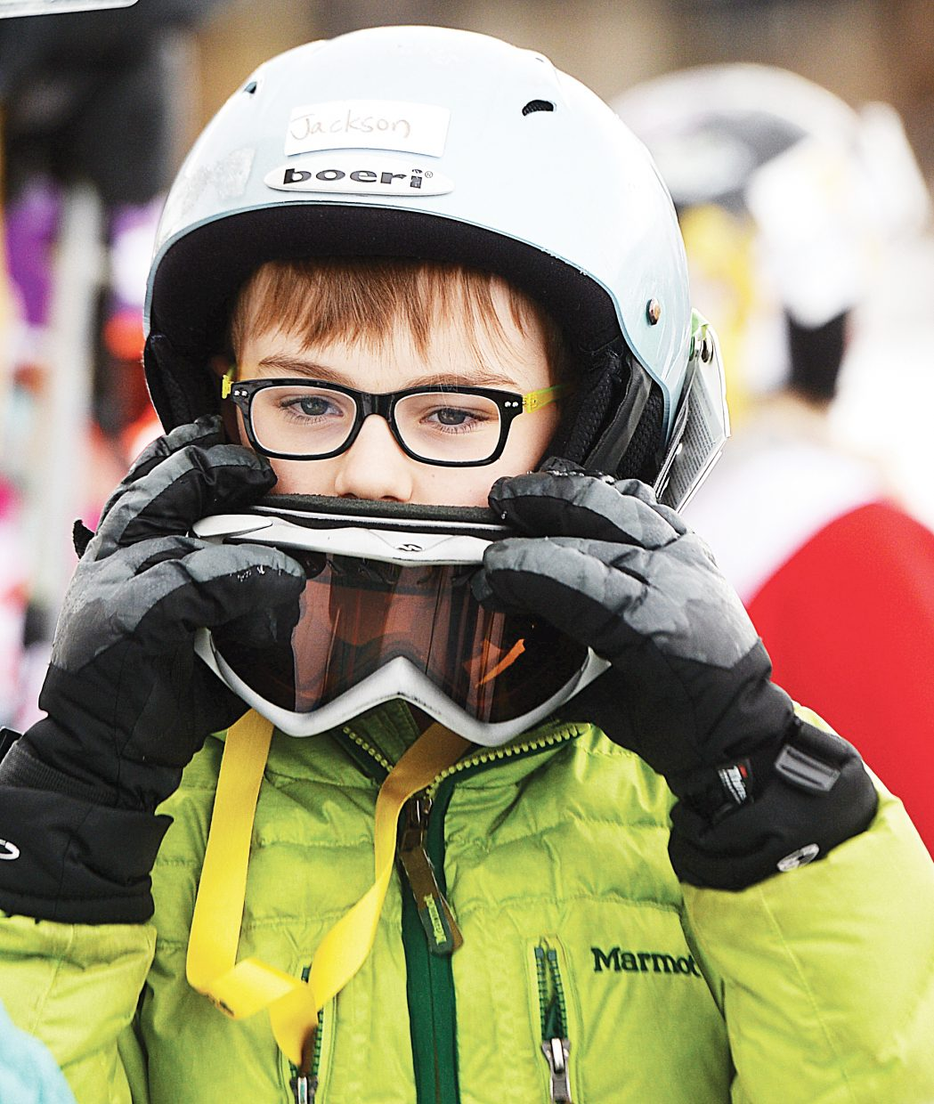 Jackson Tormey adjusts his goggles Friday morning while waiting for his shot at the annual Christy Sports Soda Pop Slalom, which was held at the base of Steamboat Ski Area.