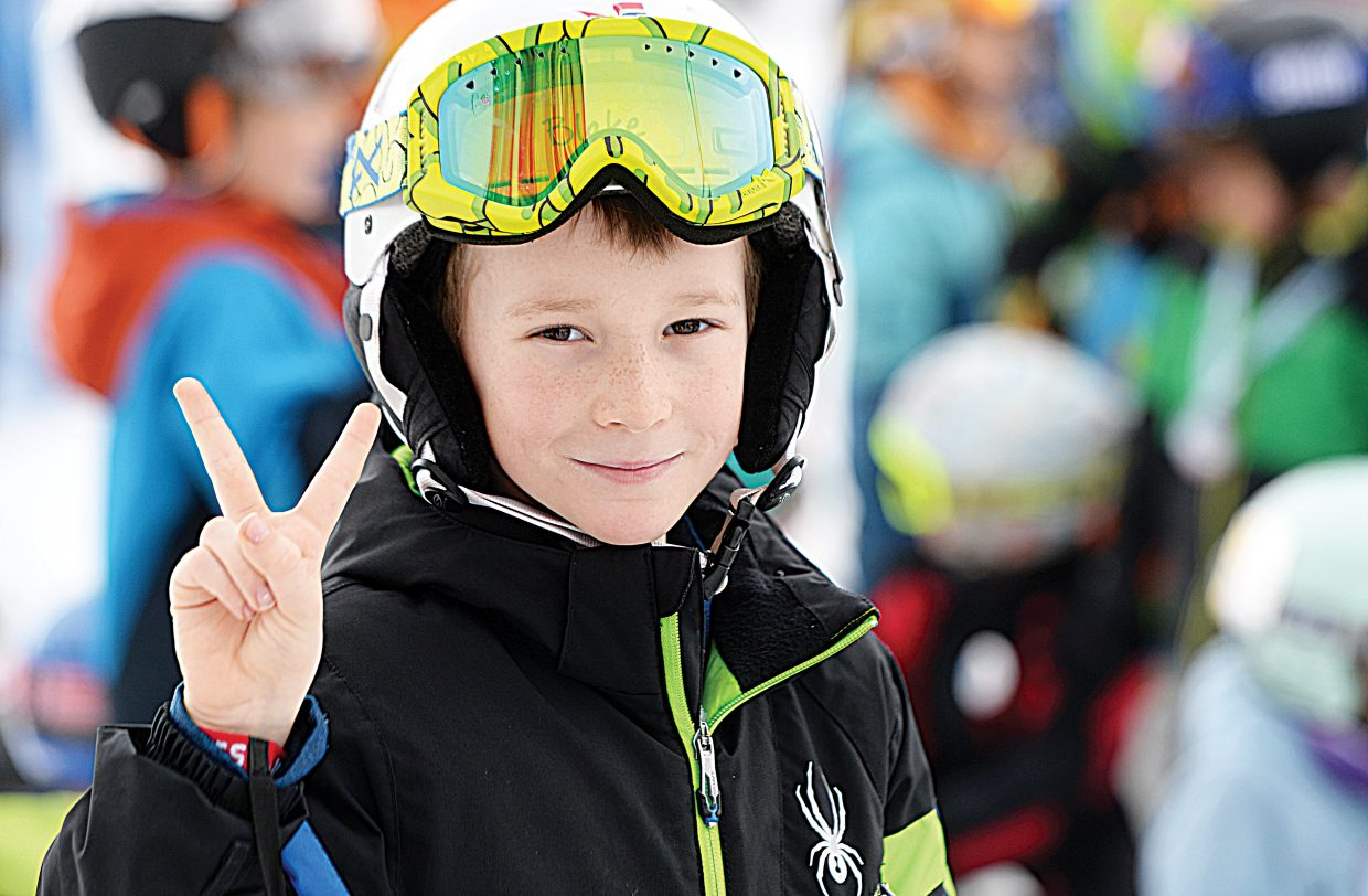 Blake Packard flashes a peace symbol while waiting for his run Friday morning at the annual Christy Sports Soda Pop Slalom, which was held at the base of Steamboat Ski Area.