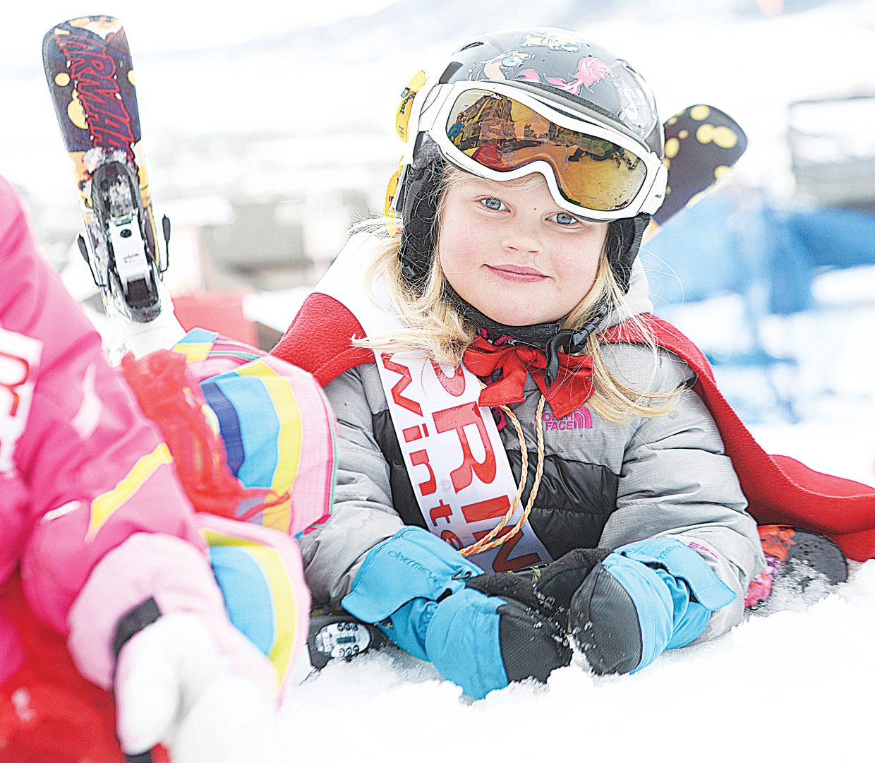 Simone Bastone-Russell got comfortable while waiting for her turn in Friday morning's Christy Sports Soda Pop Slalom Friday morning at Steamboat Ski Area.