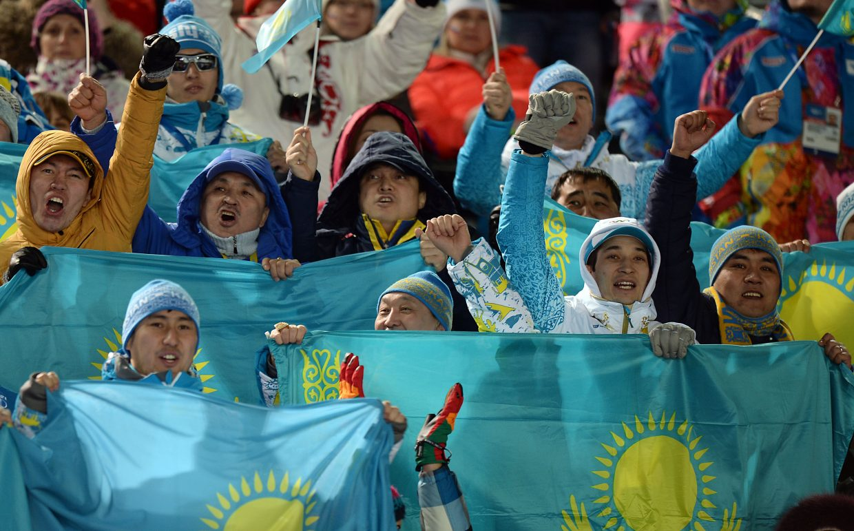 Fans from Kazakhstan roar after their countryman Dmitriy Reiherd puts down a solid run Monday during the men's moguls competition at the Winter Olympics. Reinherd finished fifth.