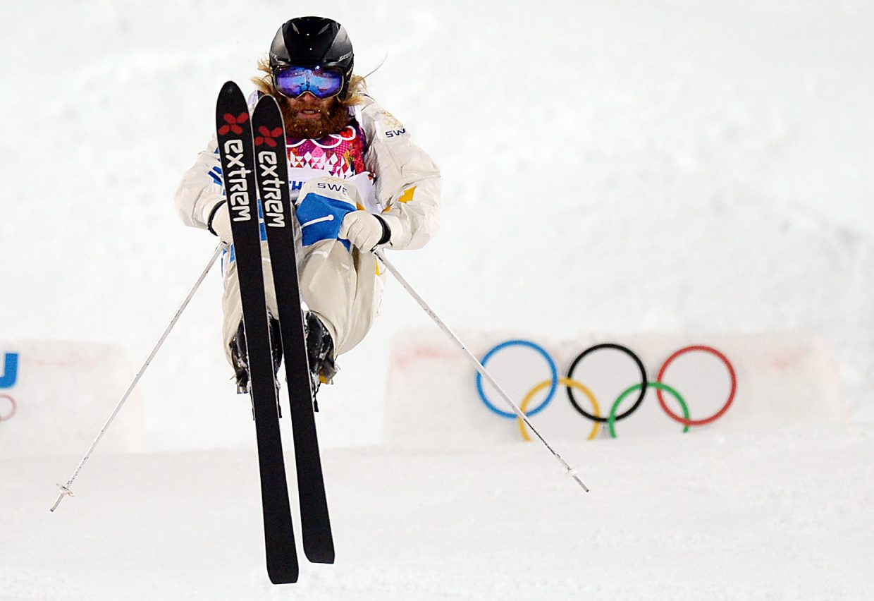 Swedish moguls skier Per Spett flips through a trick Monday during the men's moguls competition at the Winter Olympics.