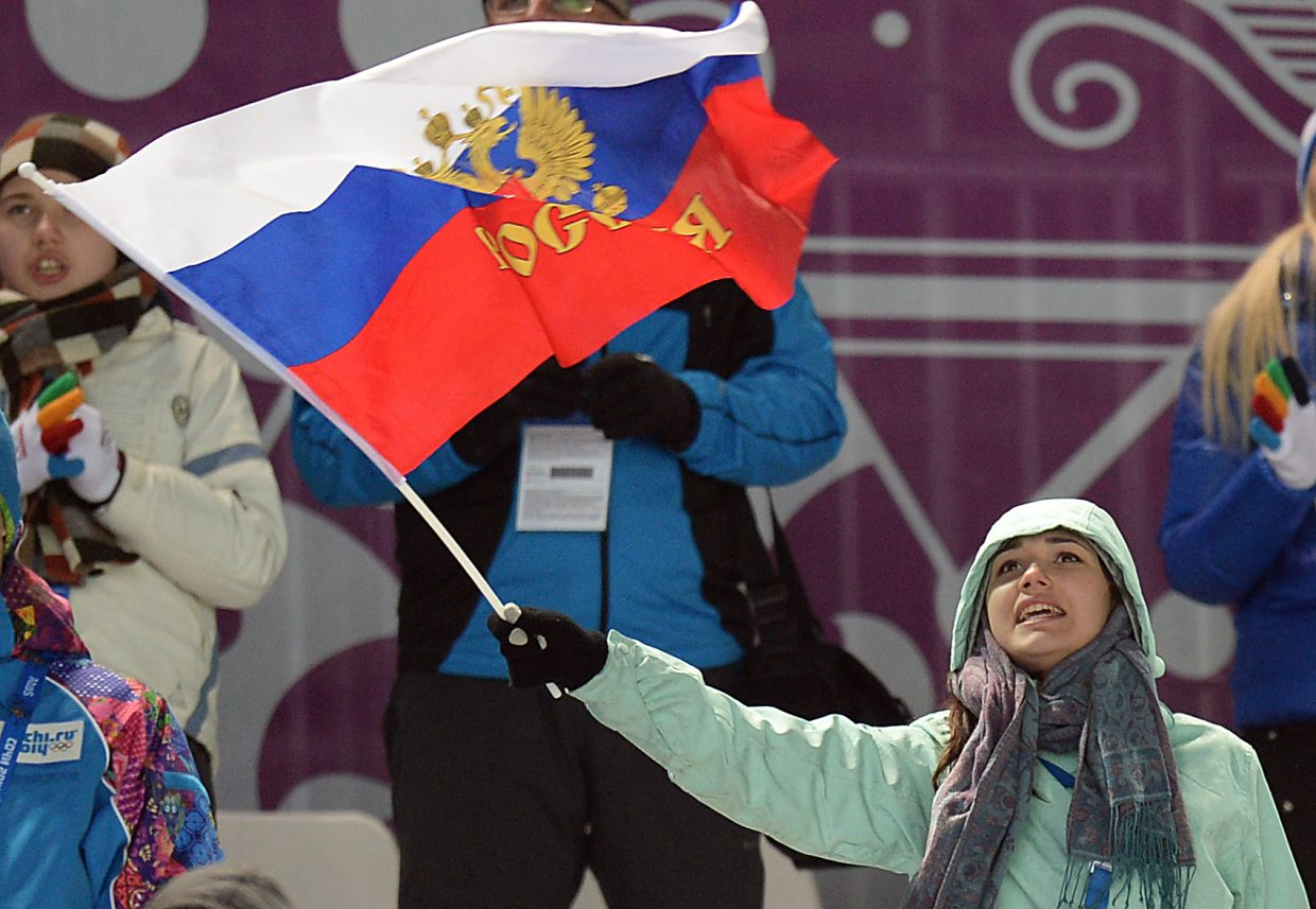 A Russian fan waves her support of skier Alexandr Smyshlyaev, who won a bronze medal in front of the home crowd.