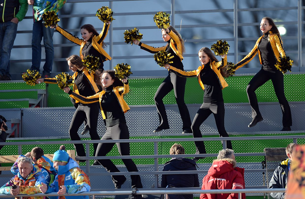 What's a Nordic combined competition without some cheerleaders? Fortunately, those watching the men's normal hill competition at the Winter Olympics didn't have to find out Wednesday.