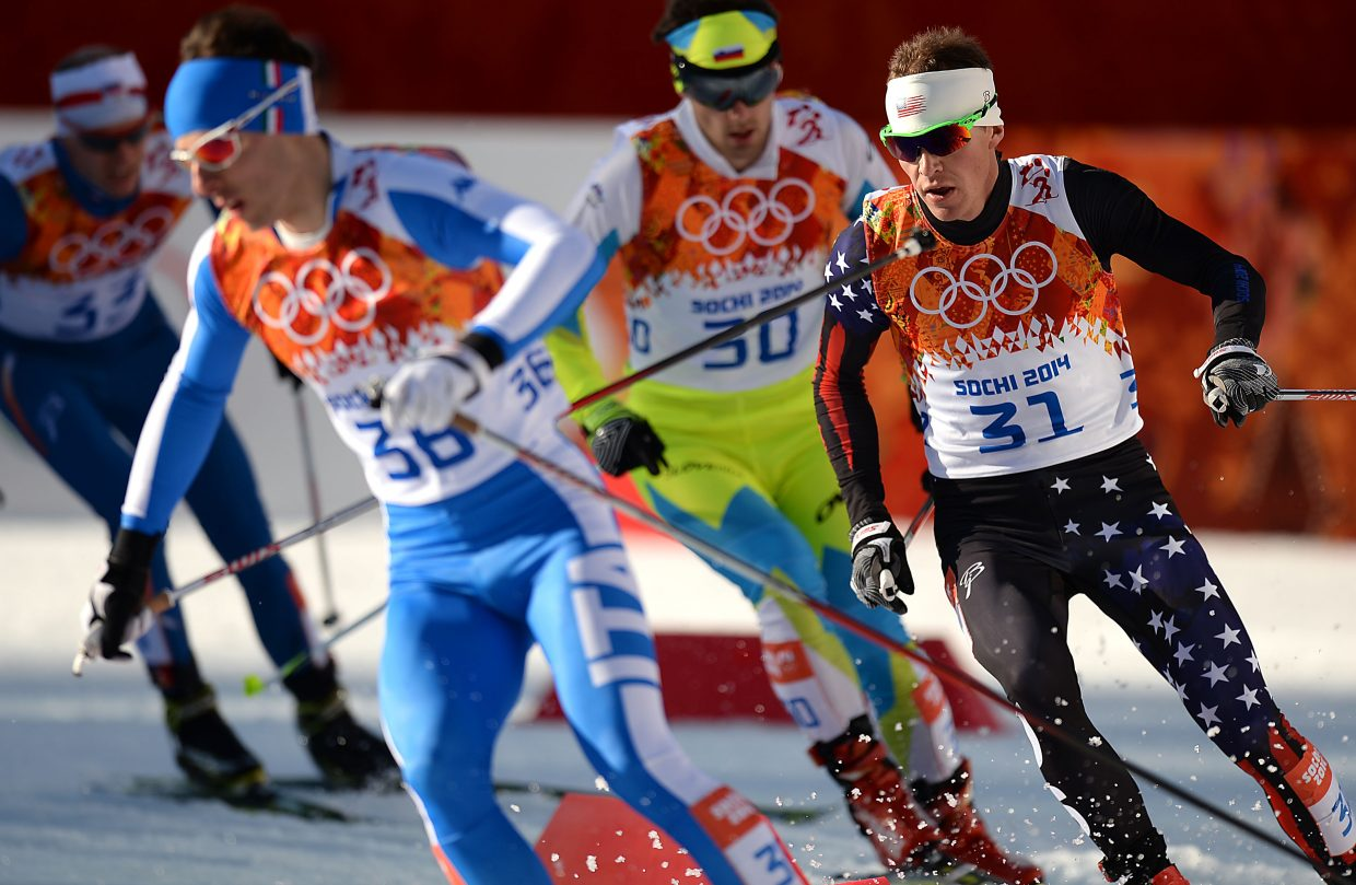 Bill Demong skis through the RusSki Gorki Jumping Center in Krasnaya Polyana, Russia, on Wednesday during the first Nordic combined competition of the Winter Olympics. Demong finished 24th, and Bryan Fletcher was 26th. Taylor Fletcher finished 33rd.