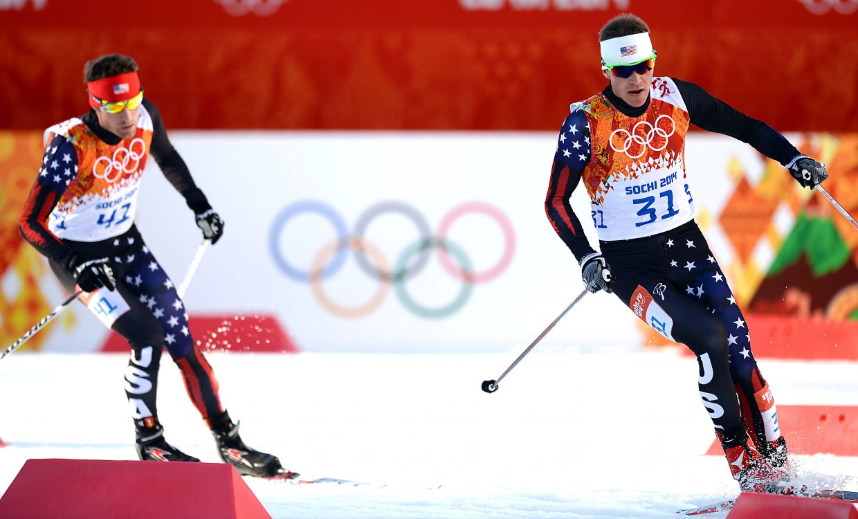 Bill Demong and Bryan Fletcher ski through the RusSki Gorki Jumping Center in Krasnaya Polyana, Russia, on Wednesday during the first Nordic combined competition of the Winter Olympics. Demong finished 24th and Bryan Fletcher was 26th. Taylor Fletcher finished 33rd.