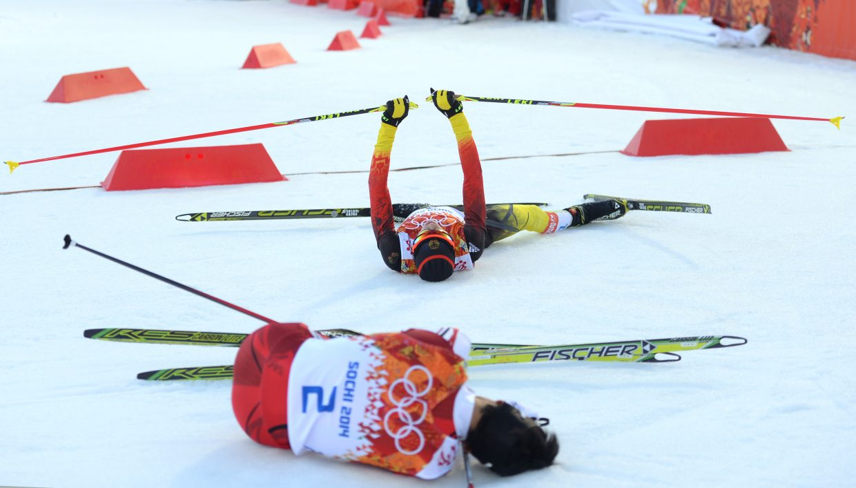 Eric Frenzel summoned the strength to lift his arms above his head after winning the gold medal in the men's normal hill Nordic combined event in Krasnaya Polyana, Russia, on Wednesday. Akito Watabe, bottom, was second.
