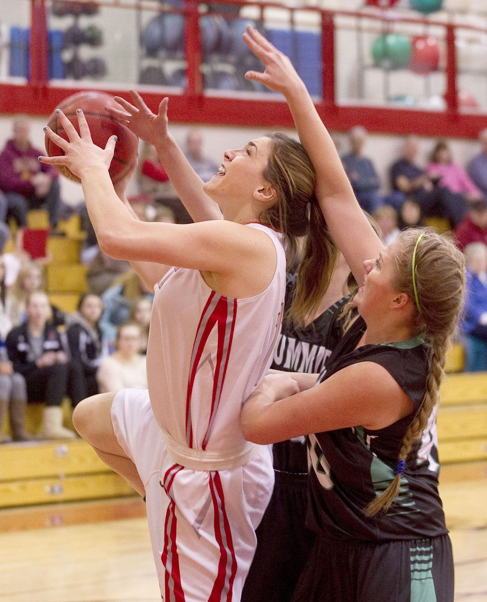 Steamboat Springs senior Maddie Robertson has the ball knocked away as she drives to the basket in the first half of Tuesday night's 49-28 victory against Summit County.