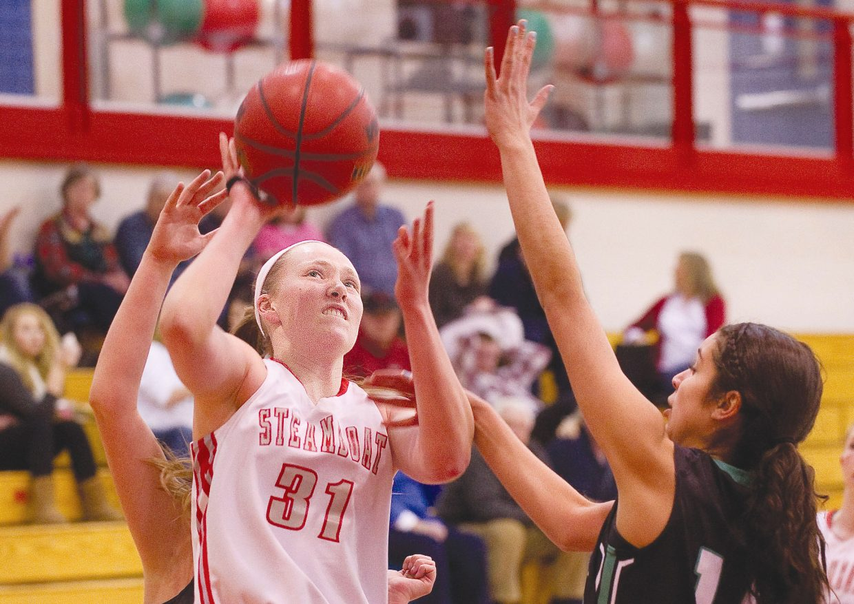 Steamboat Springs senior Maggie Crouch is fouled while taking a shot in the first half of Tuesday night's 49-28 win against Summit County.