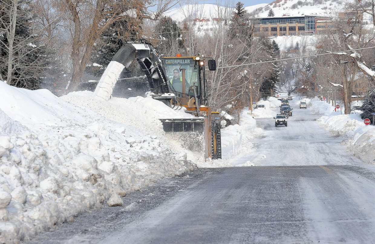 """Daryl Kemry uses an """"industrial-sized"""" snow blower to widen the streets in downtown Steamboat Springs Tuesday morning. The snow from last week's storms piled up across the county, and crews were working to clear the snow in preparation for the next big storm."""
