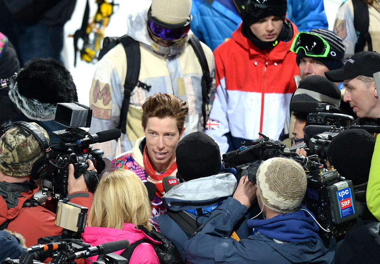 United States snowboarder Shaun White fields questions from the press Monday after a half-pipe training session at Rosa Khutor Extreme Park in Russia. The men's half-pipe event begins Wednesday.