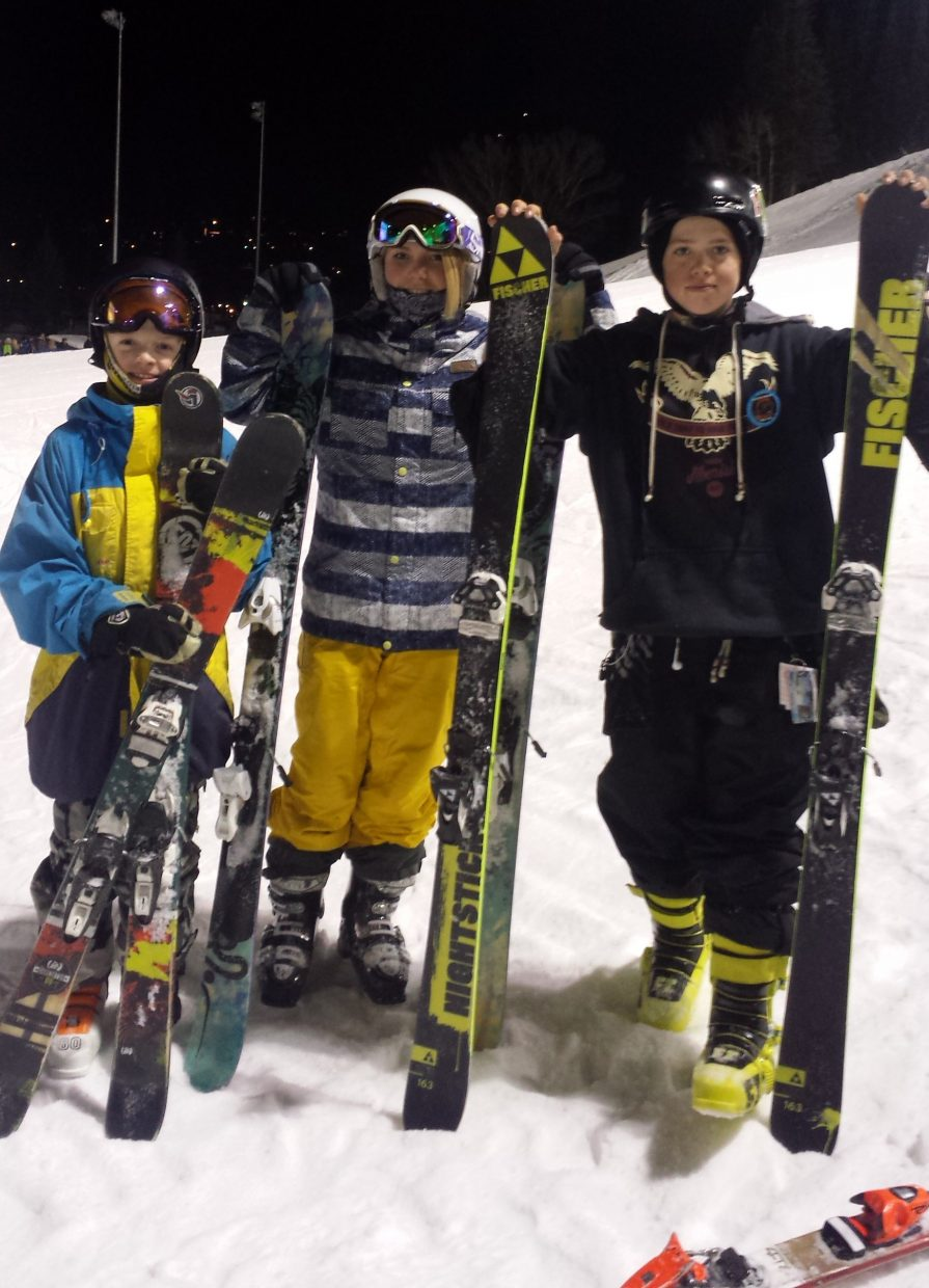 Steamboat Springs Winter Sports Club freestyle skiers, from left, Liam Baxter, Josie Seibel and Kai Doyle await their trip down Howelsen Hill during Saturday's Winter Carnival night show. They had to leave a USASA competition early in order to make it home for the event, which was at Winter Park. There, Baxter was third, Seibel first and Doyle second in their respective divisions.