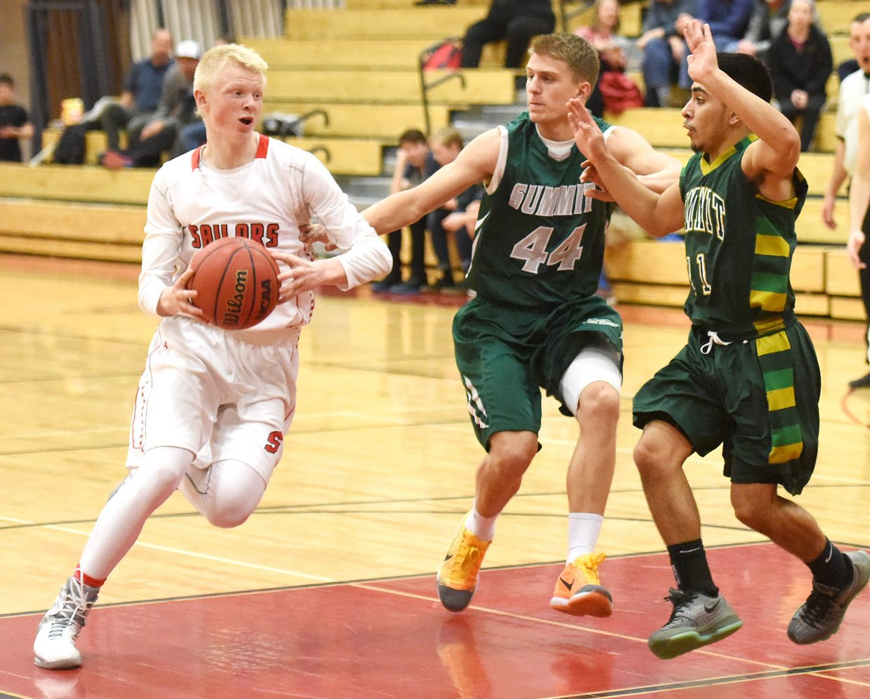 Steamboat's Ethan Riniker charges through the lane toward the basket Thursday in a win against Summit.