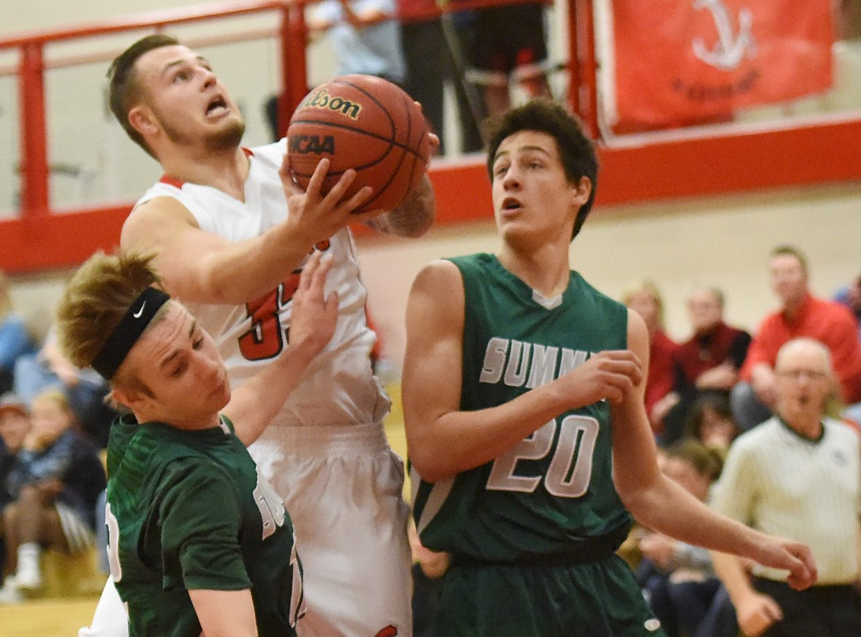 Steamboat's Zach Holm tries to get a shot up in traffic Thursday against Summit.