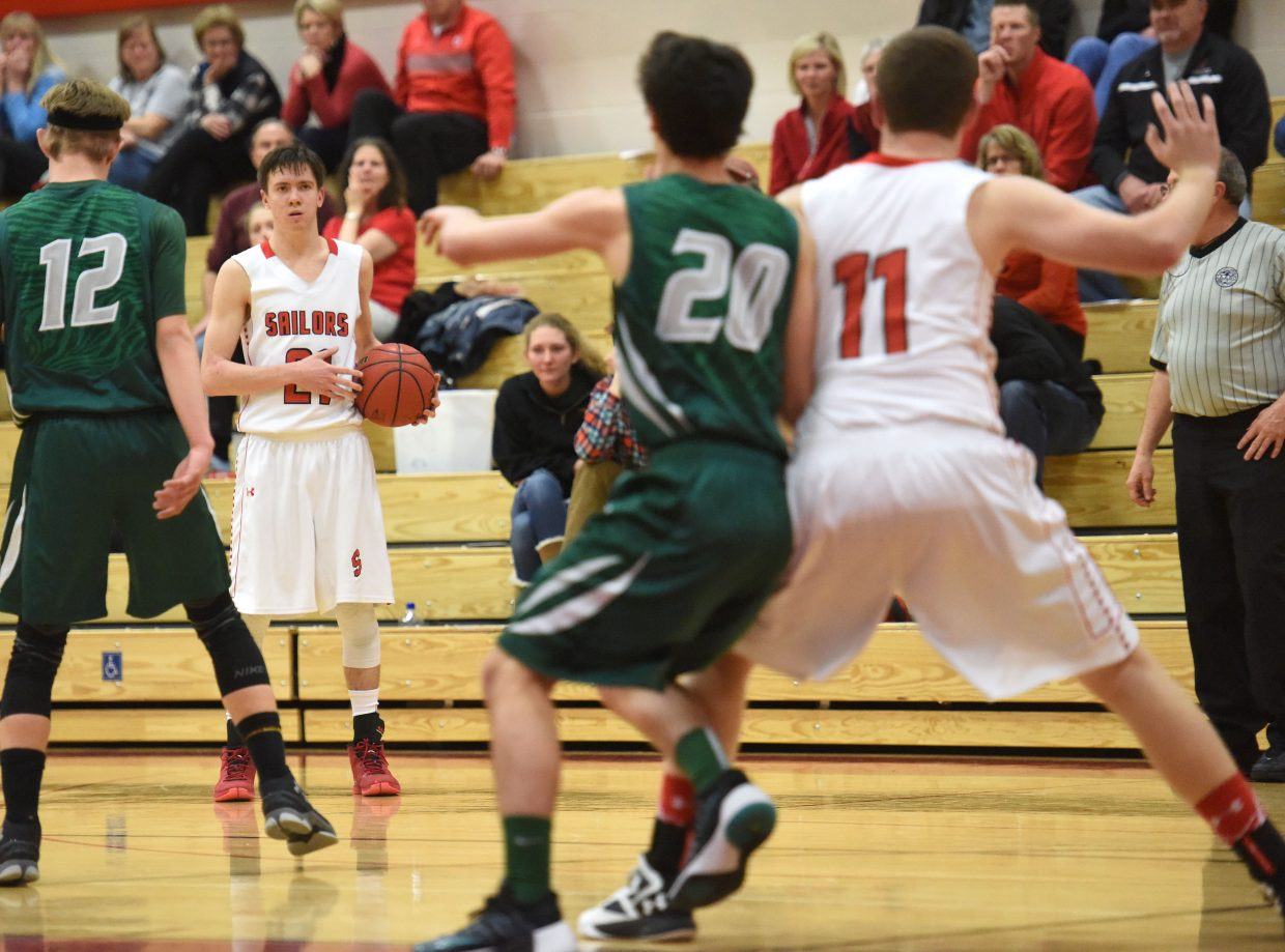 Steamboat's John Zalesky, left, looks for a pass as teammate Jacob Taulman posts up on Thursday in a win against Summit.