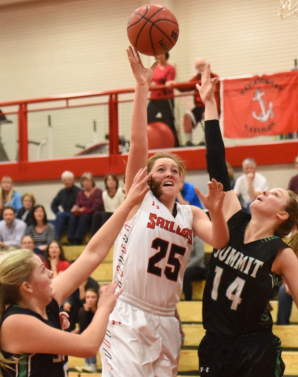 Steamboat Springs senior Jenna Miller goes up with a shot in traffic Thursday against Summit. The Sailors trailed late, but rallied to force overtime, where they won the game, 44-40.