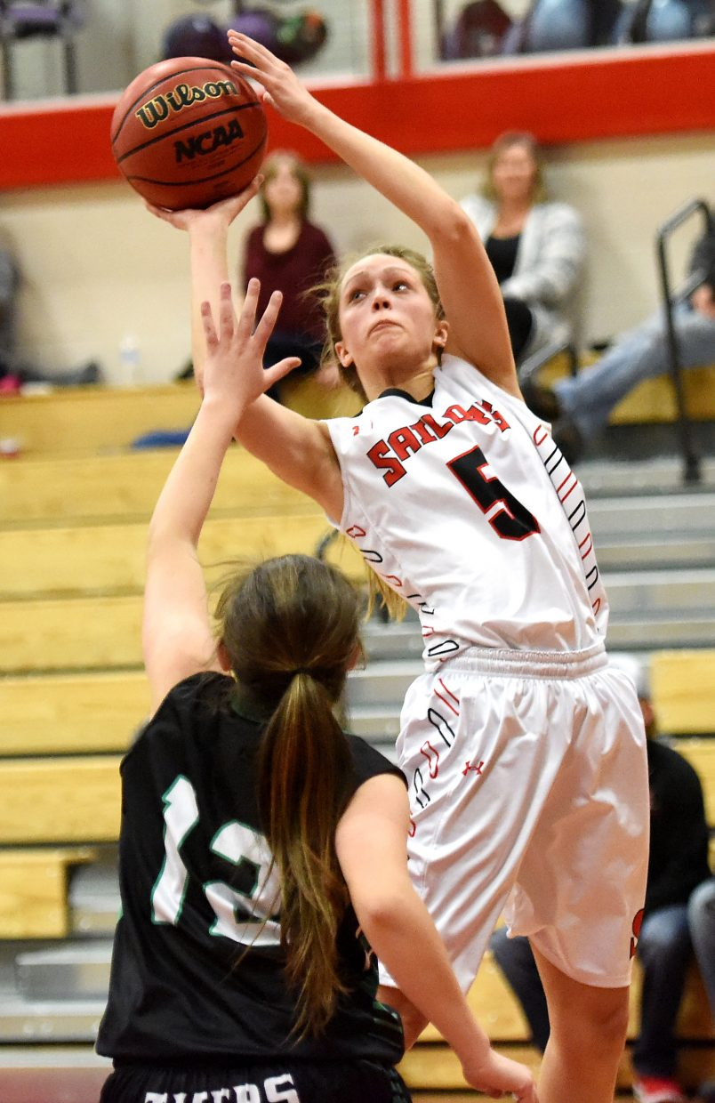 Steamboat's Maddie Clock leans into a shot Thursday in a win against Summit.