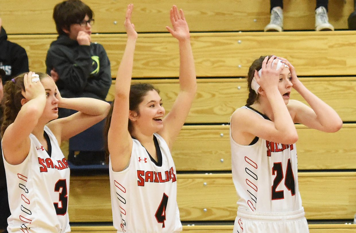 Reactions were mixed from Steamboat Springs' Katie Saunders, left, Sarah Heineke and Alexis Balgenorth on Thursday late in the Sailors' win against Summit.