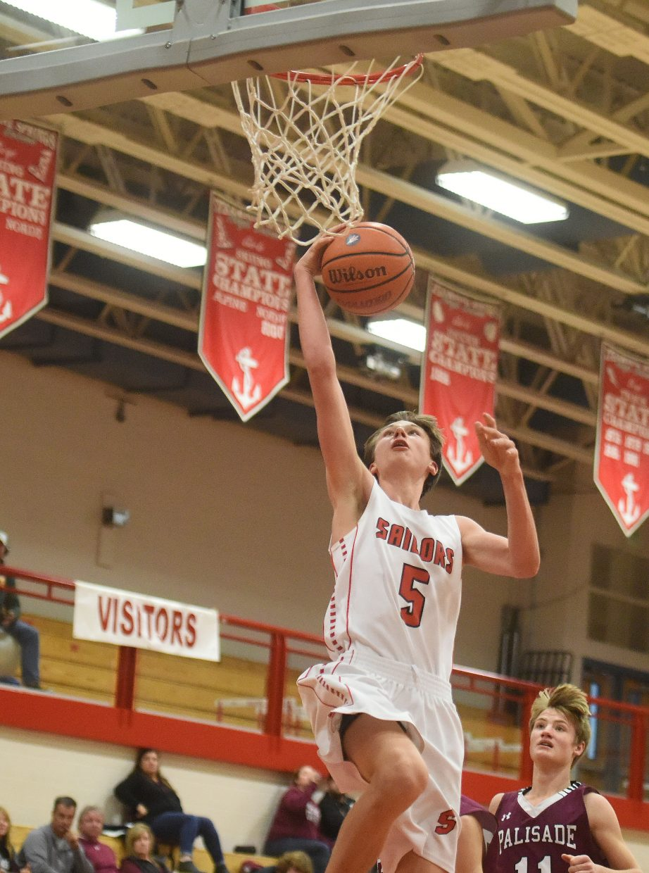 Steamboat Tyler Doyne goes up for a second-half dunk on Saturday as the Sailors beat Palisade.
