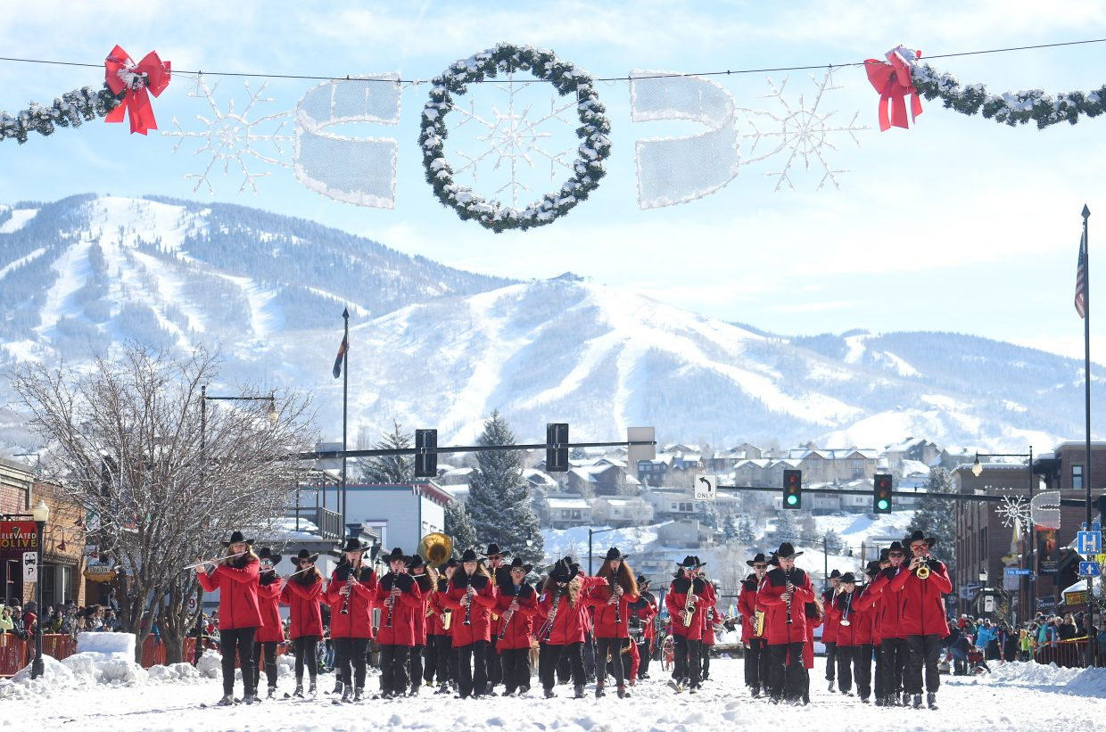 Tradition continued: The Steamboat Springs High School band heads down Lincoln Avenue on skis Sunday morning at the annual diamond hitch parade during the Winter Carnival in downtown Steamboat.
